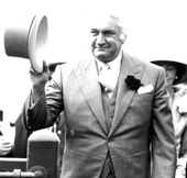 Image of Sir John Kerr at the races.